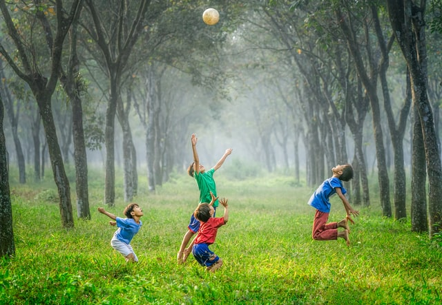 Children happily playing outside